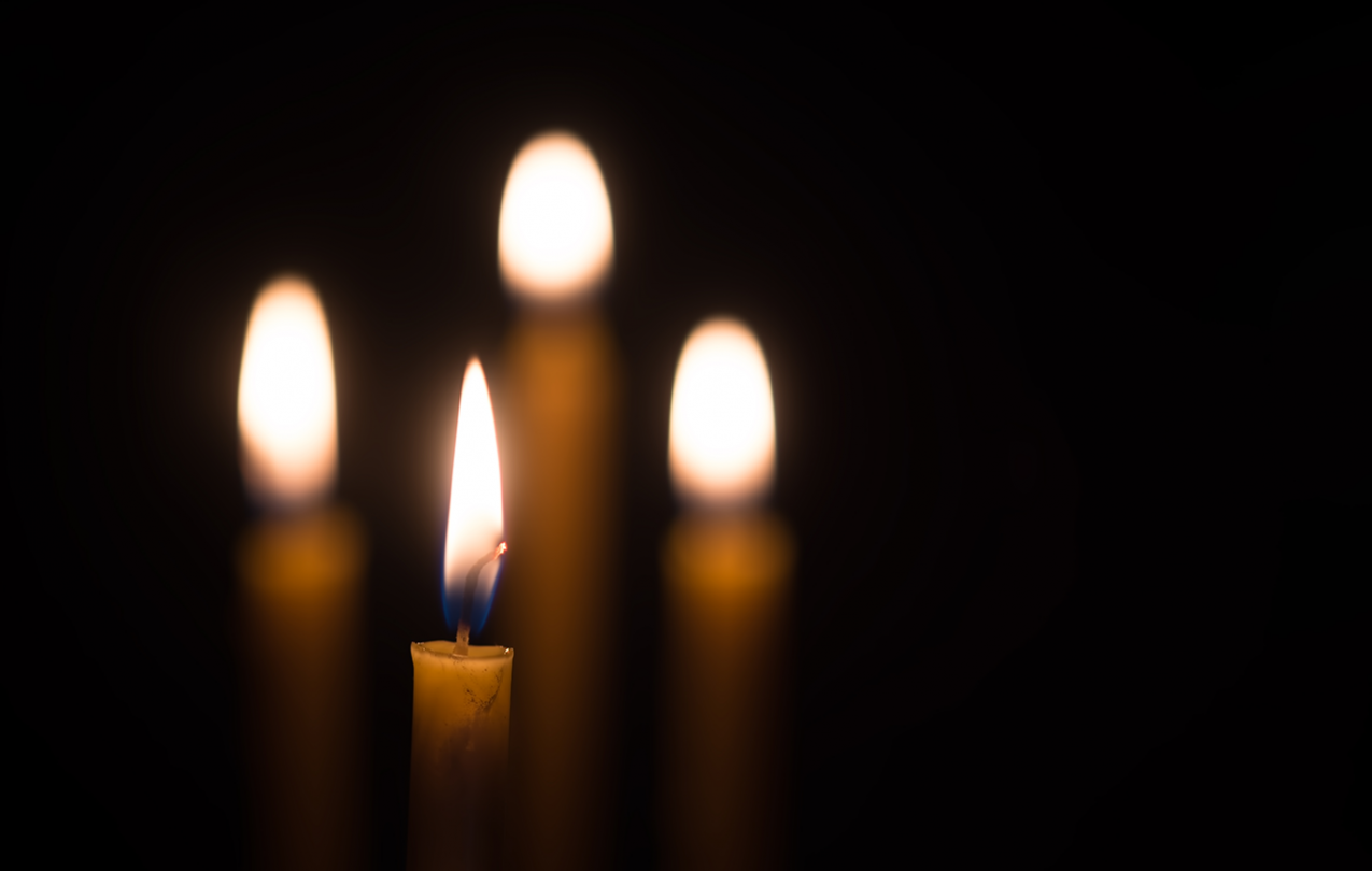 Candles in dark room